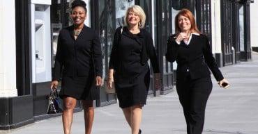 group of women walk down the street