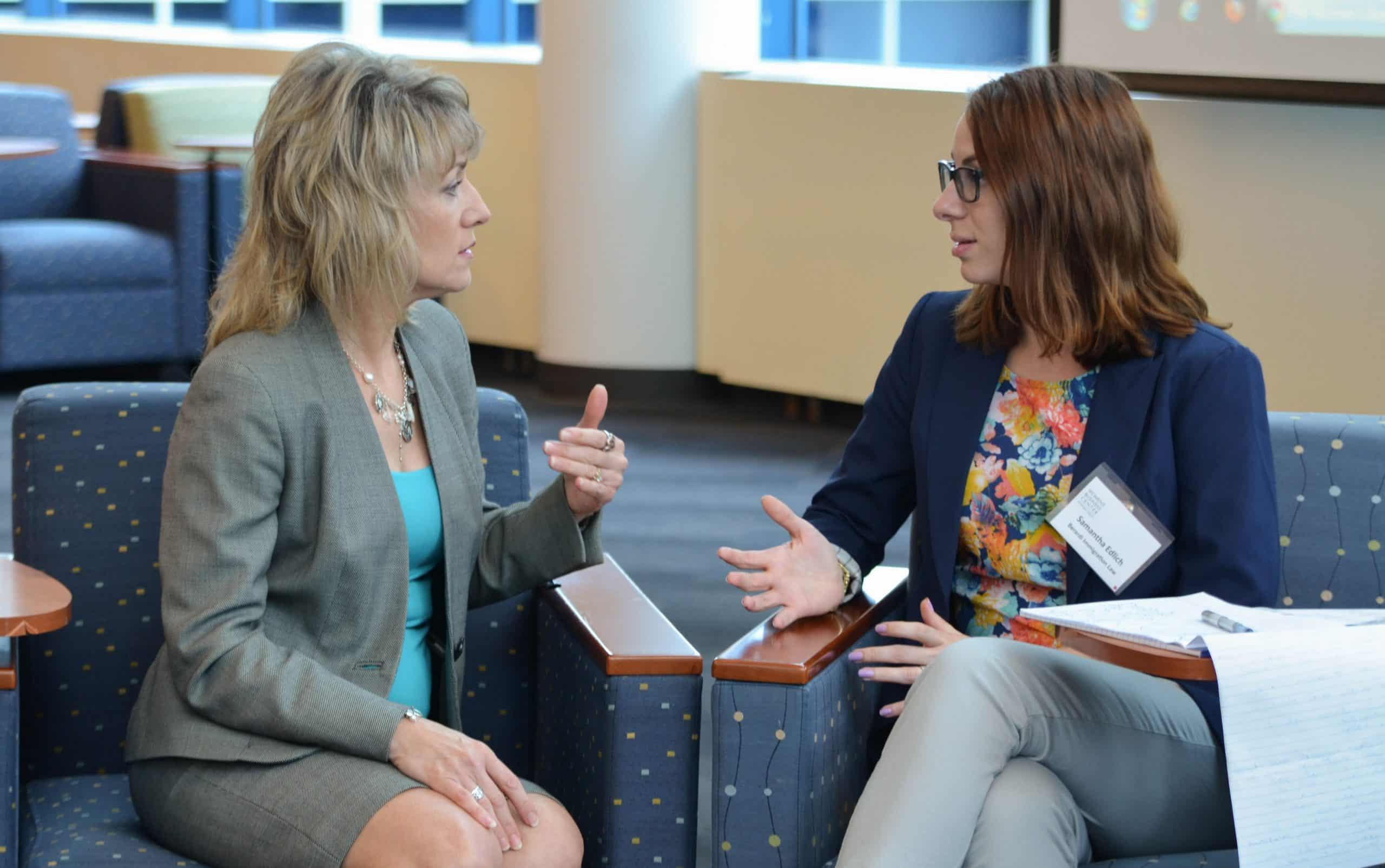 Lynn Rybak speaks to a client
