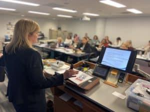 facilitator speaking to students